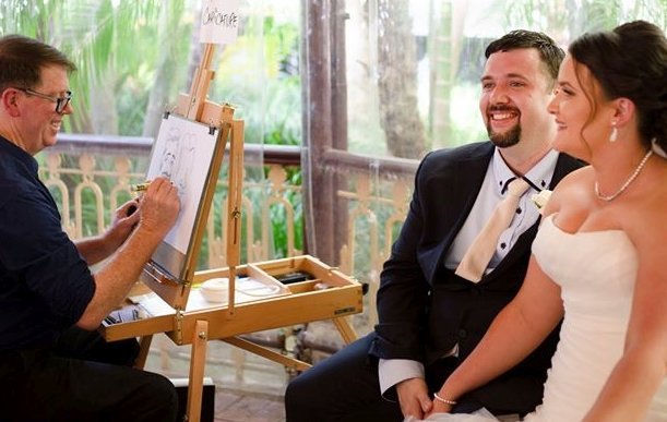 Live caricature drawing of a smiling wedding couple