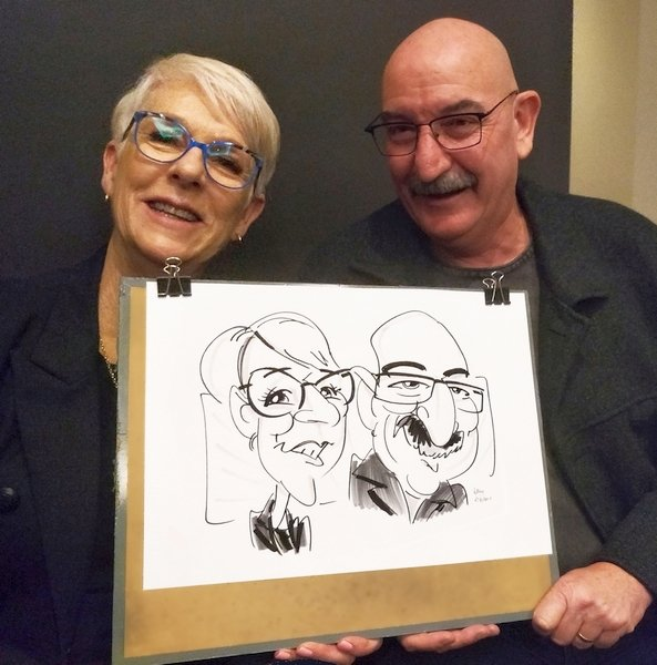 Two people happily display their funny portrait